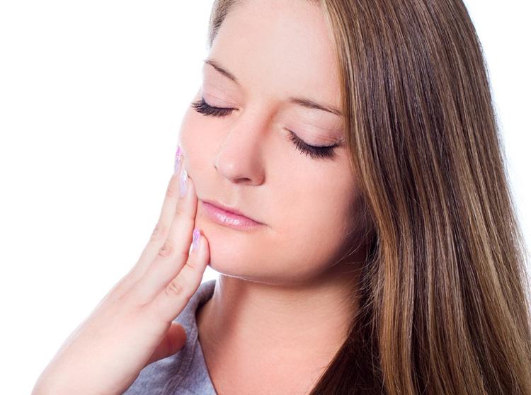 Киста десны зуба симптомы и лечение
